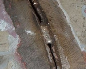 It is important to open up the crack in order to get adequate penetration. Weld only one inch at a time then let cool.