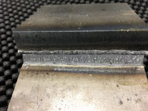 A fillet break test reveals if root fusion was achieve over a specific length of weld.