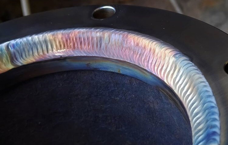 Different joints will have different levels of admixture (the mixing of weld metal with base metal) . The higher the admixture the more silicon islands will form on the surface of the weld.