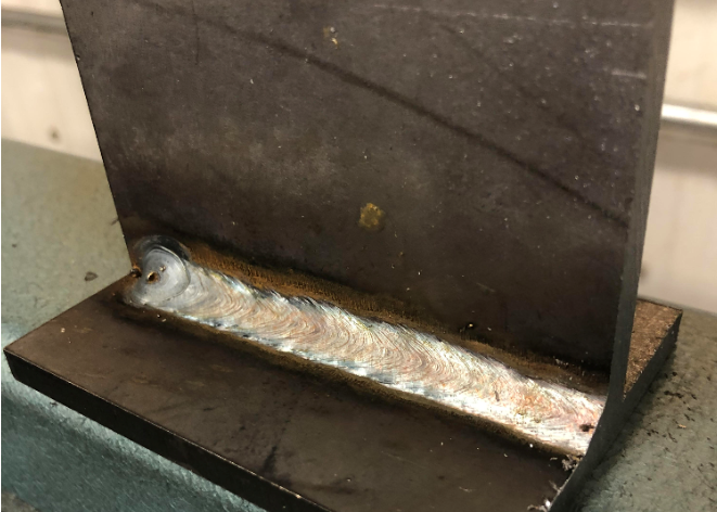 "This weld was made on 1/4"" A36 steel with 0.035"" ER70S-6 and 98%Ar/2%CO2 shielding gas in spray transfer. This shielding gas mixture is for GMAW of stainless steels."